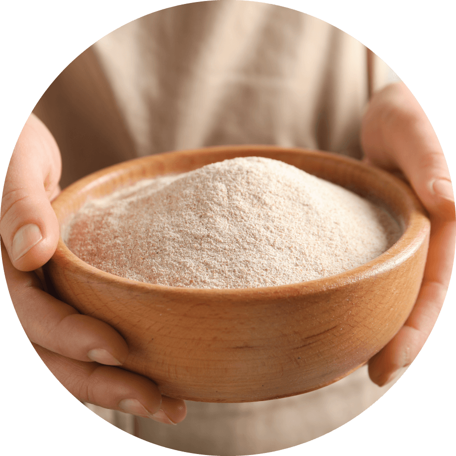 person holding bowl of buckwheat flour